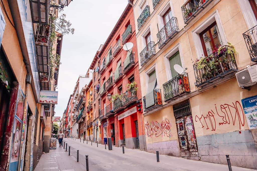 Non Touristy Things to do in Madrid - colorful street in Lavapies