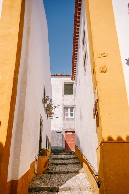 colorful alley in obidos