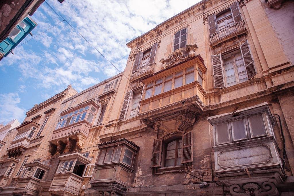 malta island images - brown balconies in Valletta