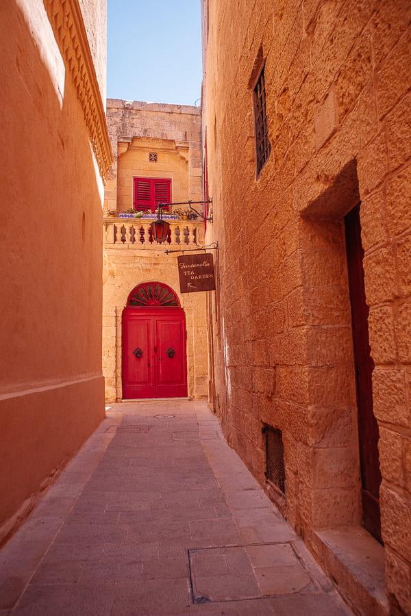 red door and balcony in Mdina