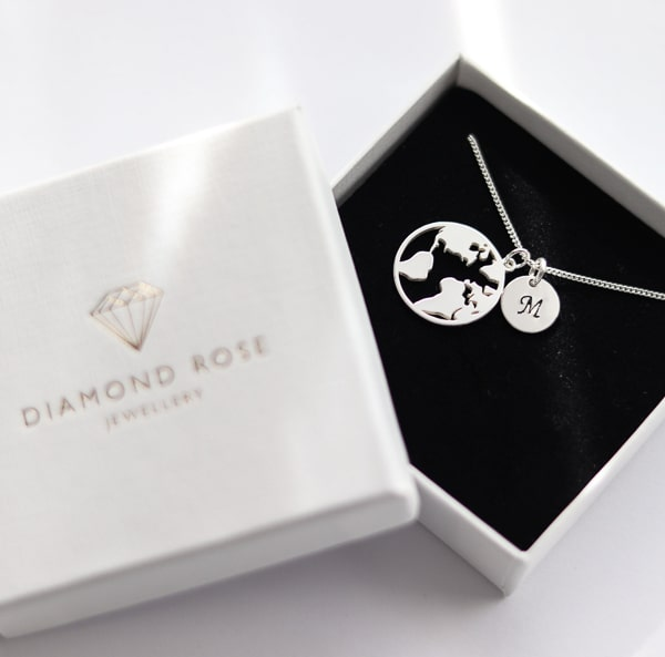 unique travel gifts for her - globe necklace